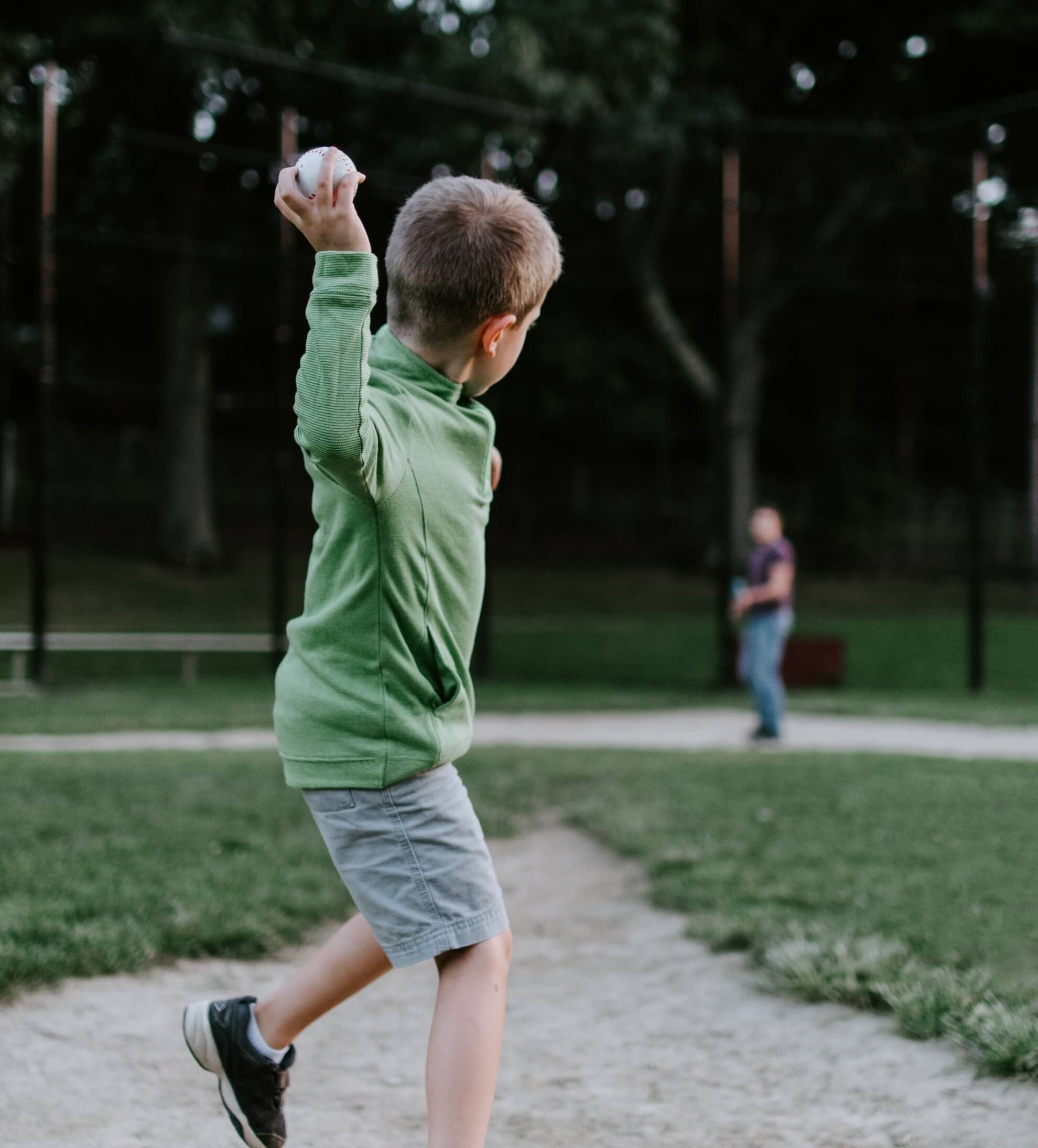 Young boy throwing a baseball to his father